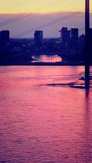 A pink sunset over the river Rhine.