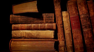 stock-footage-ancient-books-in-a-bookshelf