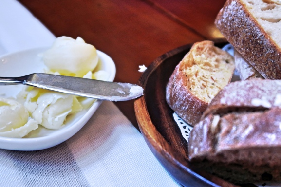 Butter curls and freshly baked bread